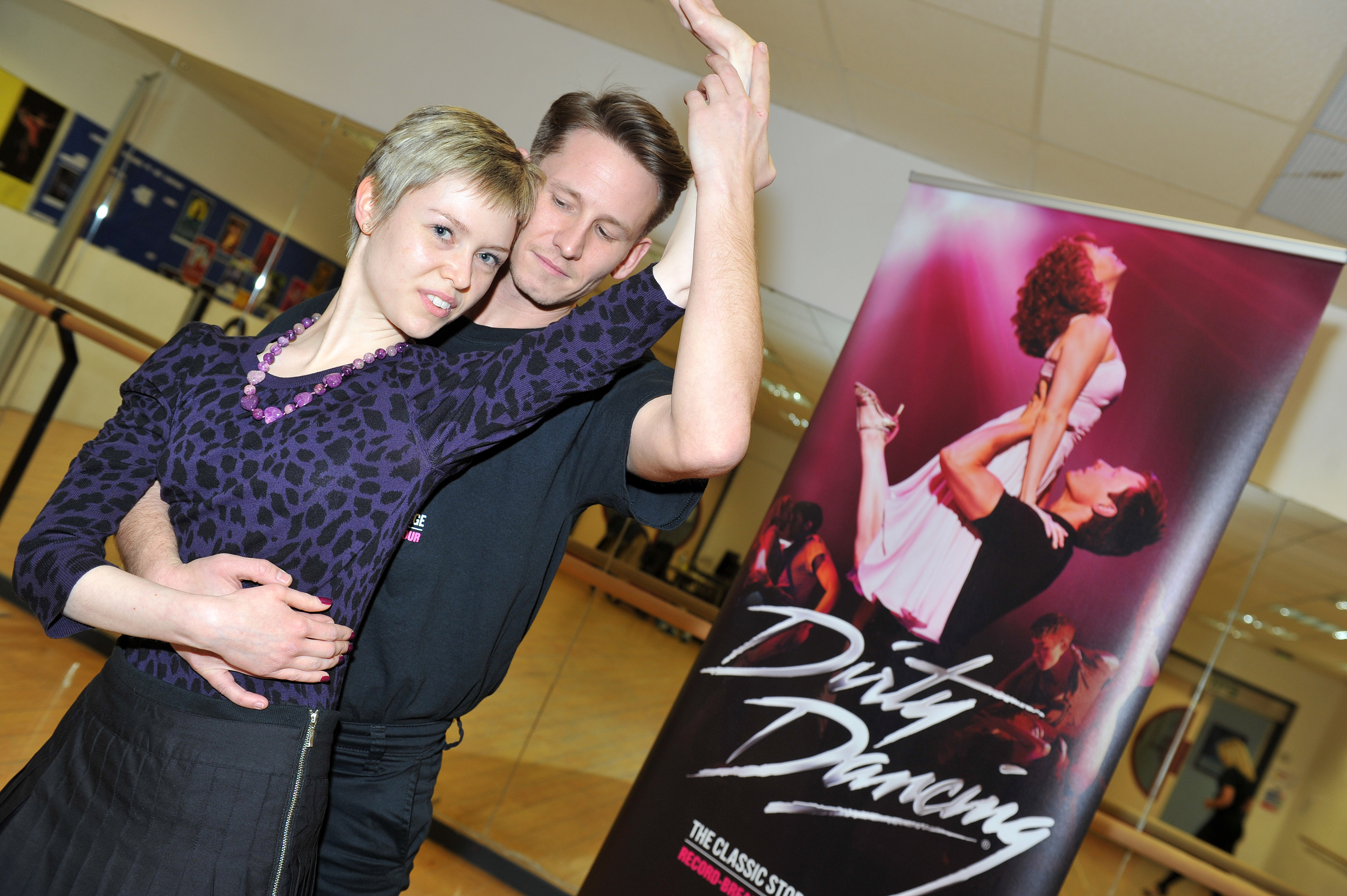 """Dirty Dancing press launch, February 2014. Georgina Butler recreates the Dirty Dancing """"tickle"""" pose with James Bennett."""
