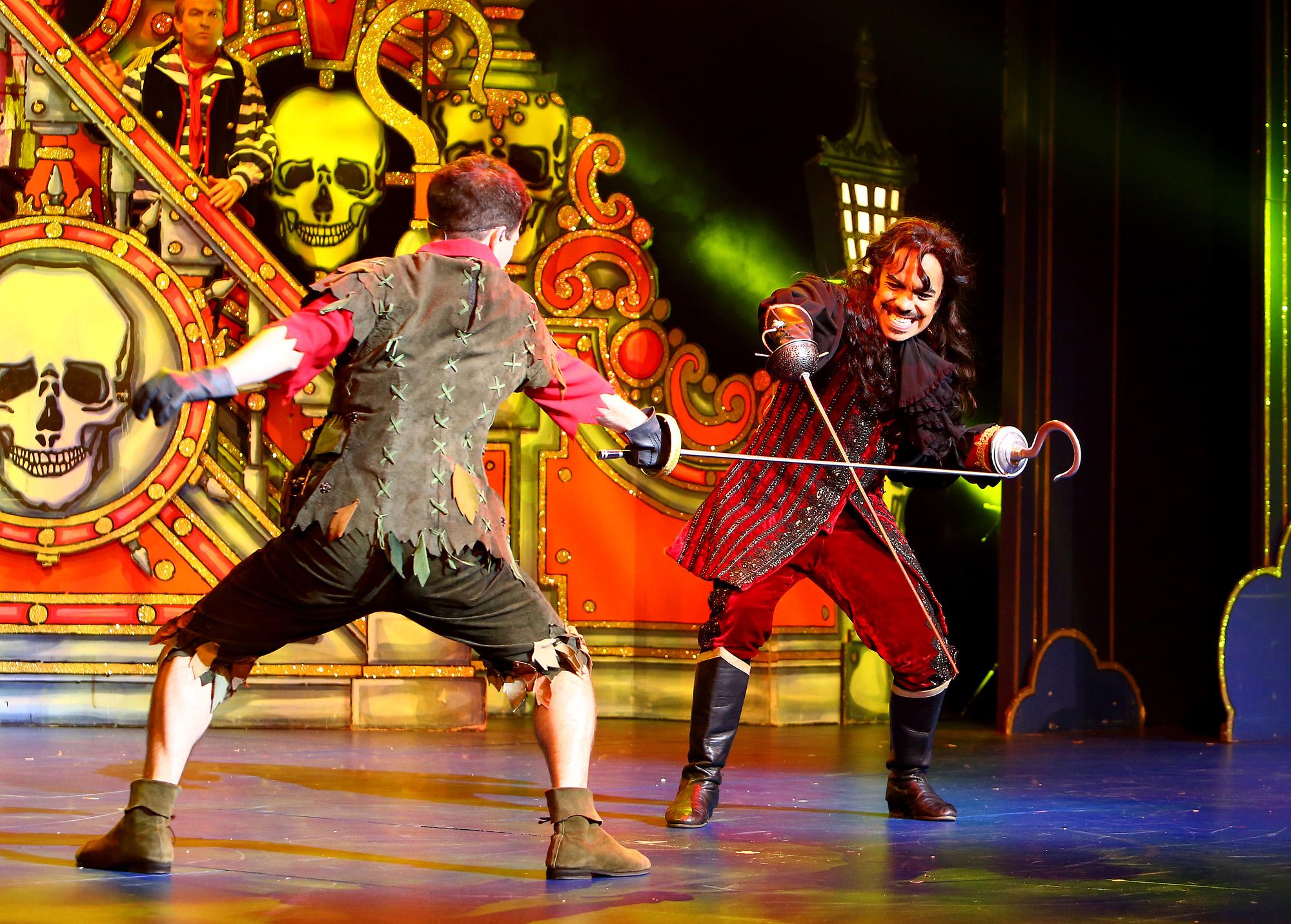 Peter Pan. George Ure as Peter Pan and David Bedella as Captain Hook in 'Peter Pan' at Milton Keynes Theatre, Christmas 2014.