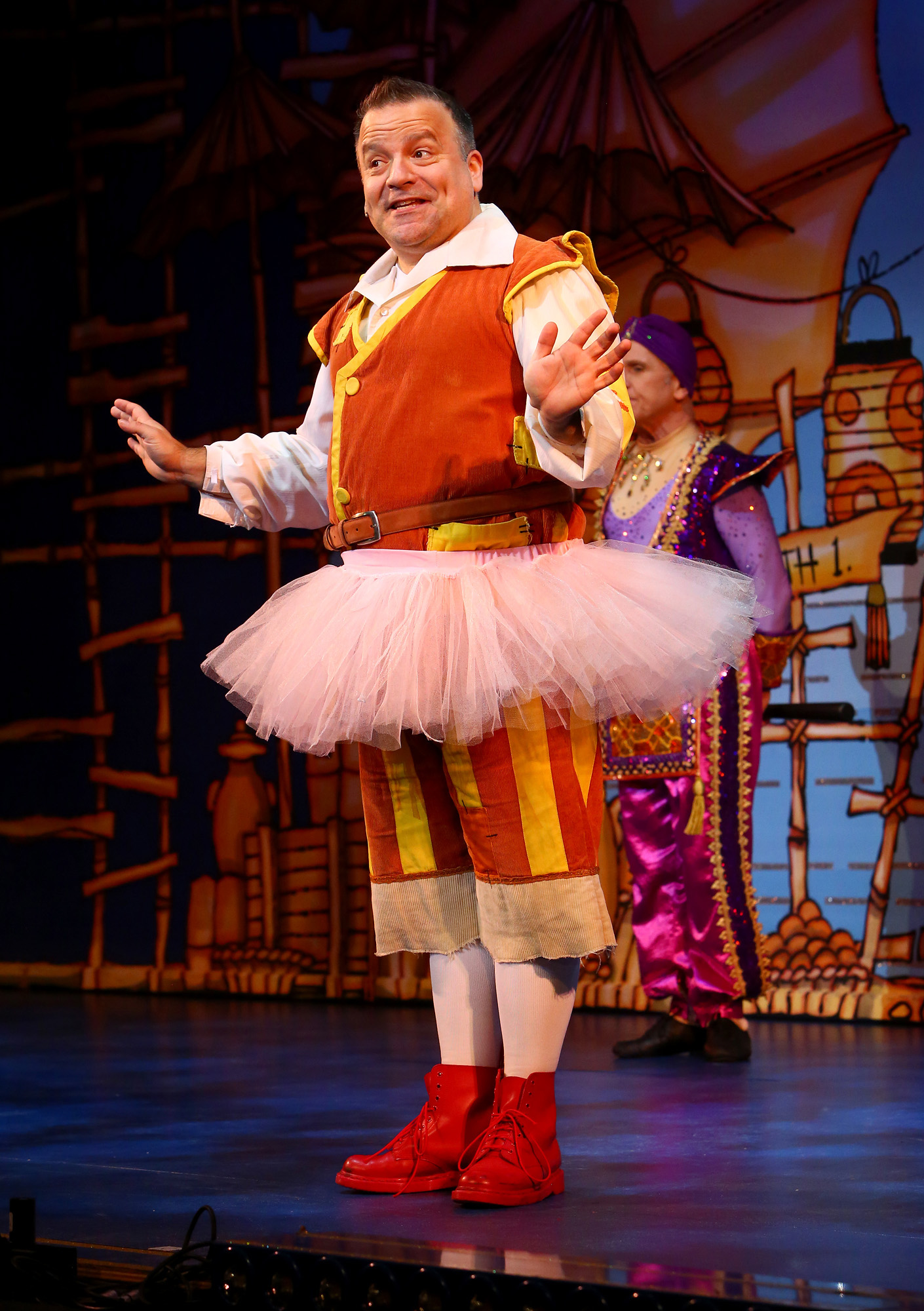 Aladdin. Kev Orkian wearing a tutu. Milton Keynes Theatre pantomime, Christmas 2015. Aladdin stars Priscilla Presley, Gary Wilmot, Ben Adams, Wayne Sleep, Kev Orkian, Mark Pickering, Aimie Atkinson and Phil Holden.