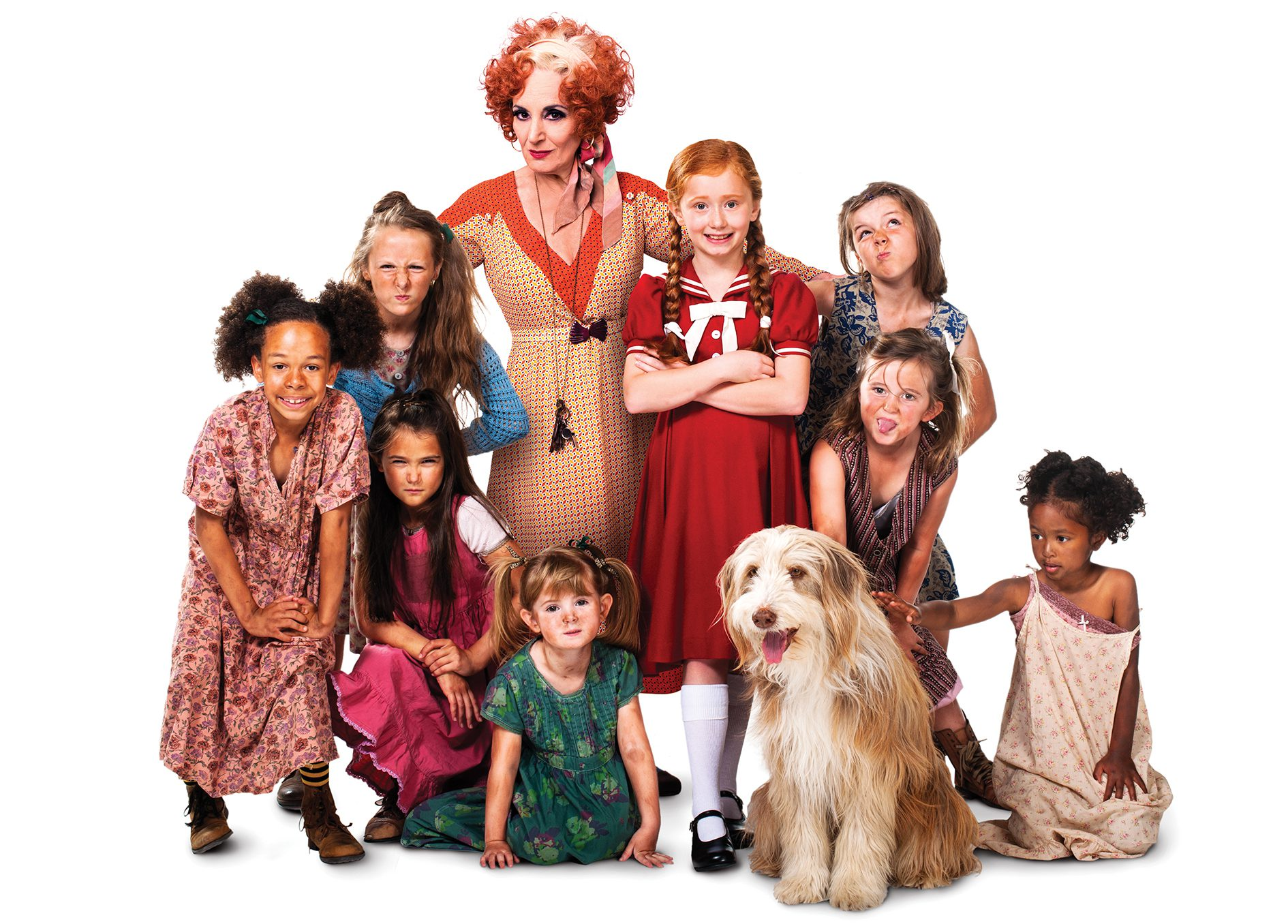 ANNIE - Lesley Joseph as Miss Hannigan with Annie and orphans. Photo credit Matt Crockett