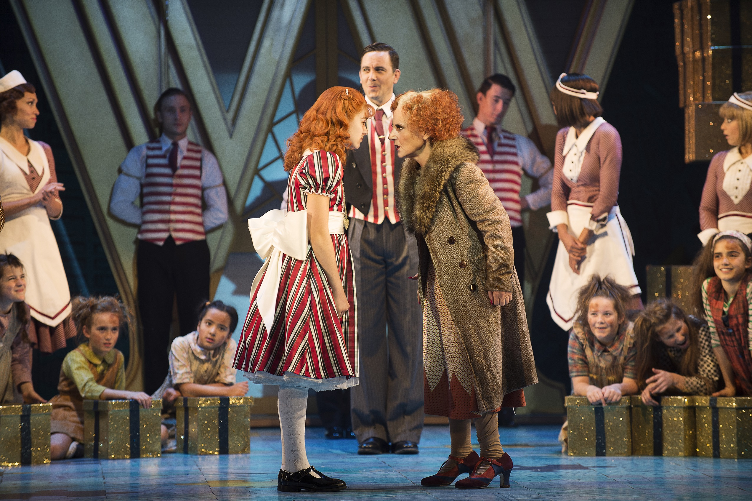 ANNIE - The Company and Lesley Joseph as 'Miss Hannigan'. Photo credit Paul Coltas
