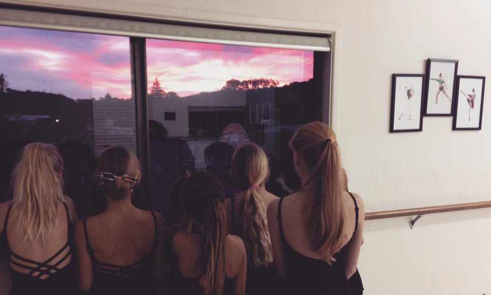 Pupils watch the sunset on Waiheke Island through the dance studio window. Artwork by Olivia Holland can be seen hanging on the wall.