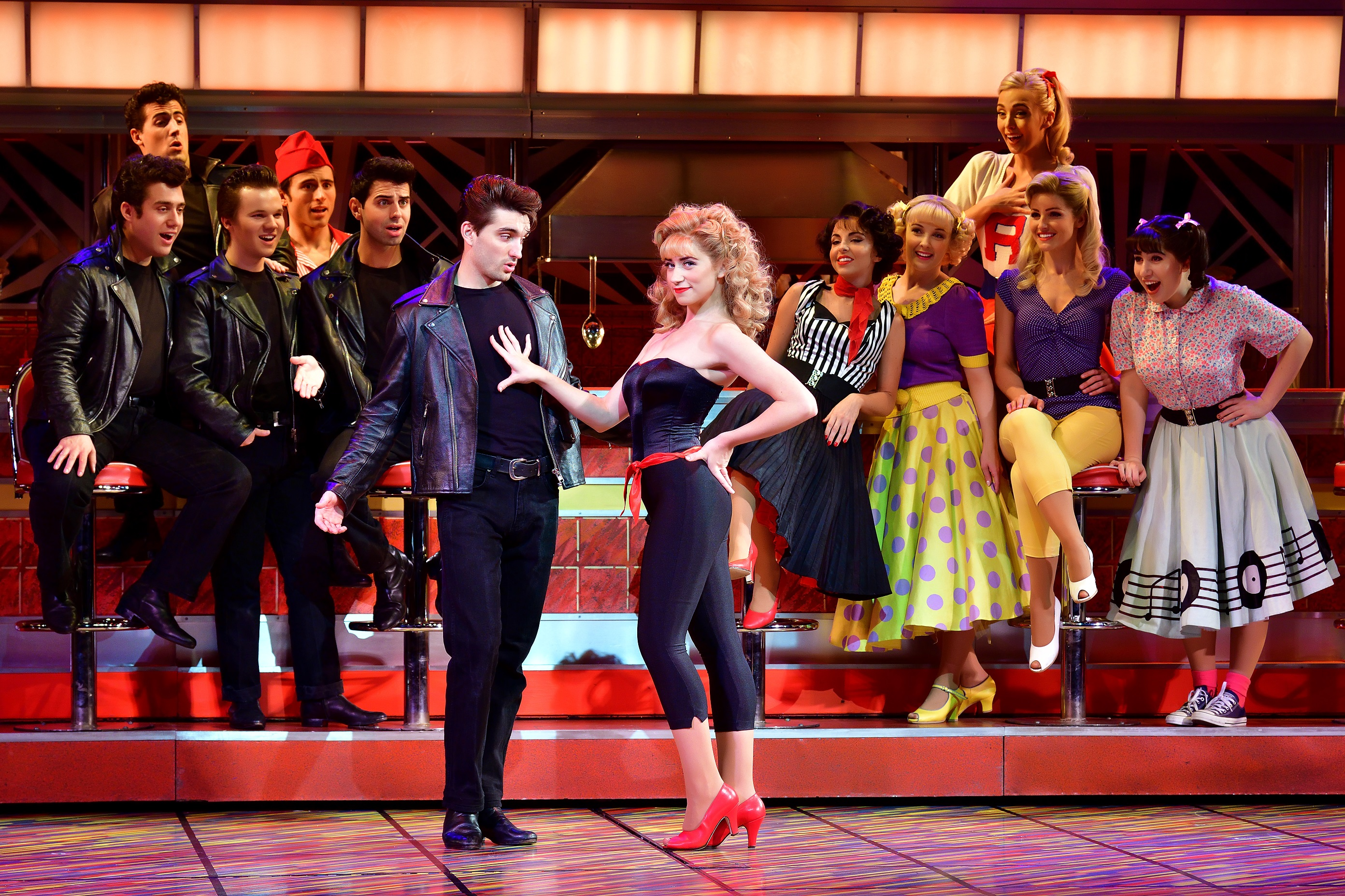 Grease the musical. Danielle Hope as Sandy Dumbrowski and Tom Parker as Danny Zuko.