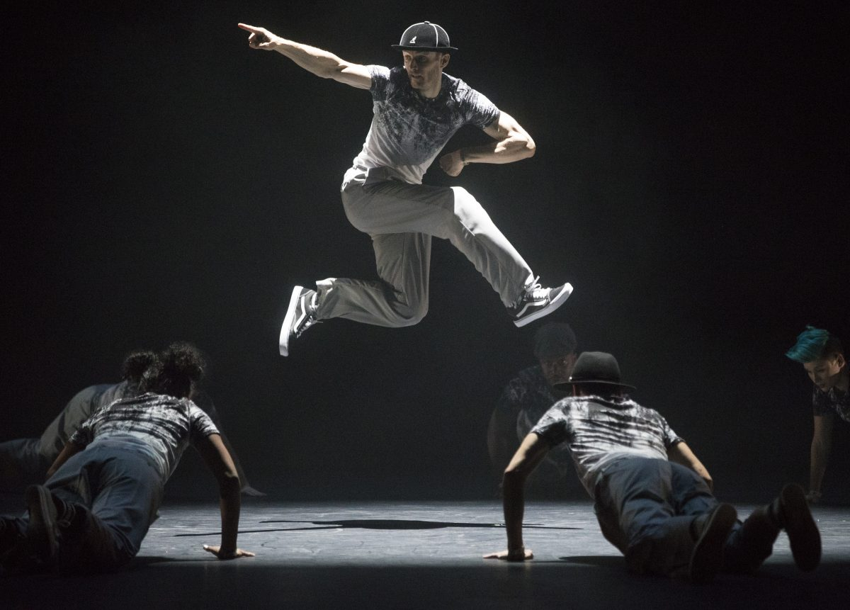"""Street Dance Glossary - The Locksmiths demonstrate a Cypher. Pronounced """"sy-fer"""", this is a term used to refer to the act of freestyling in the centre of a circle of dancers. Dancers enter the circle one by one, dancing to express themselves and entertain each other. (Photo by Paul Hampartsoumian)."""