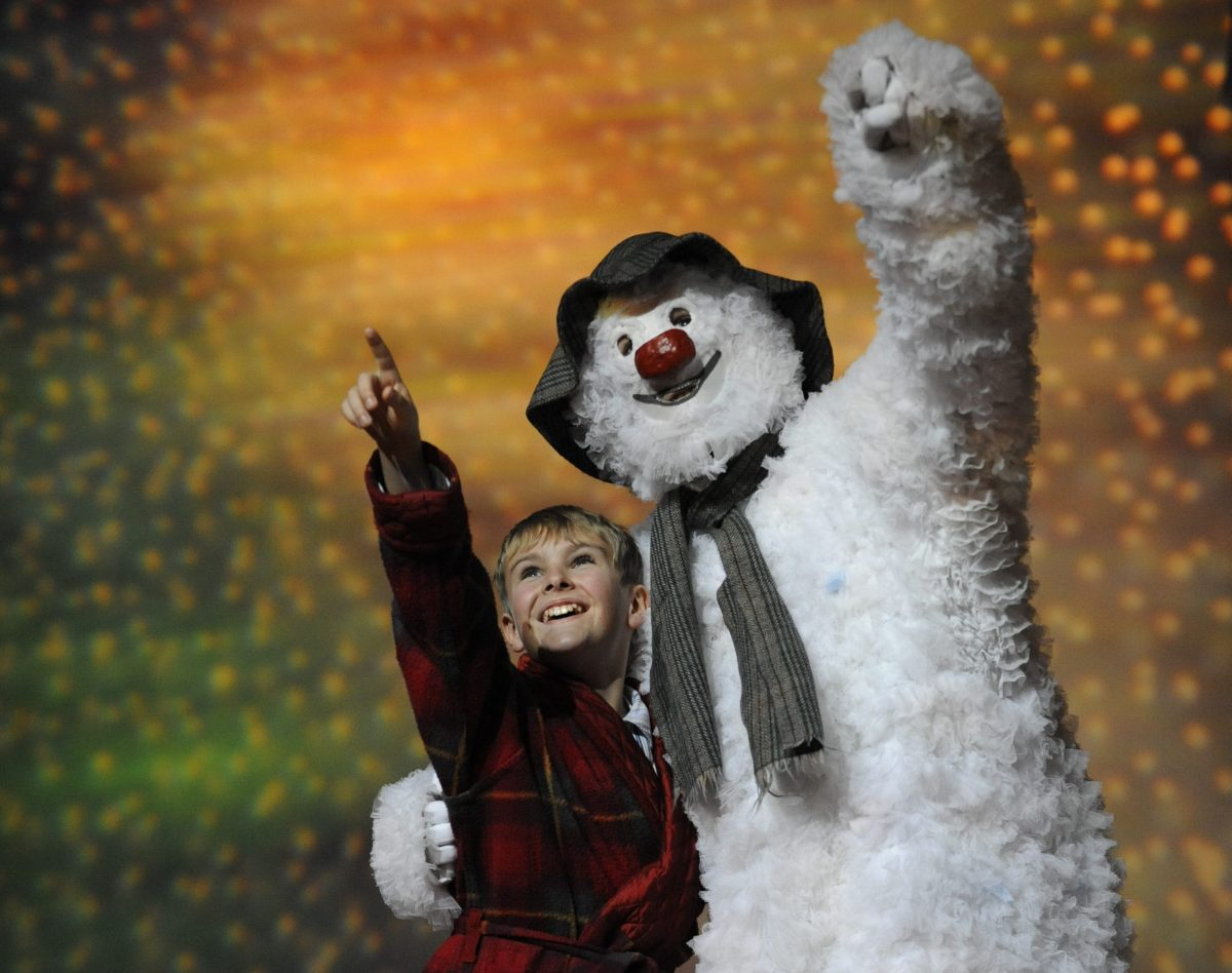The Snowman stage show directed by Bill Alexander. A boy in his pyjamas with his friend, The Snowman.