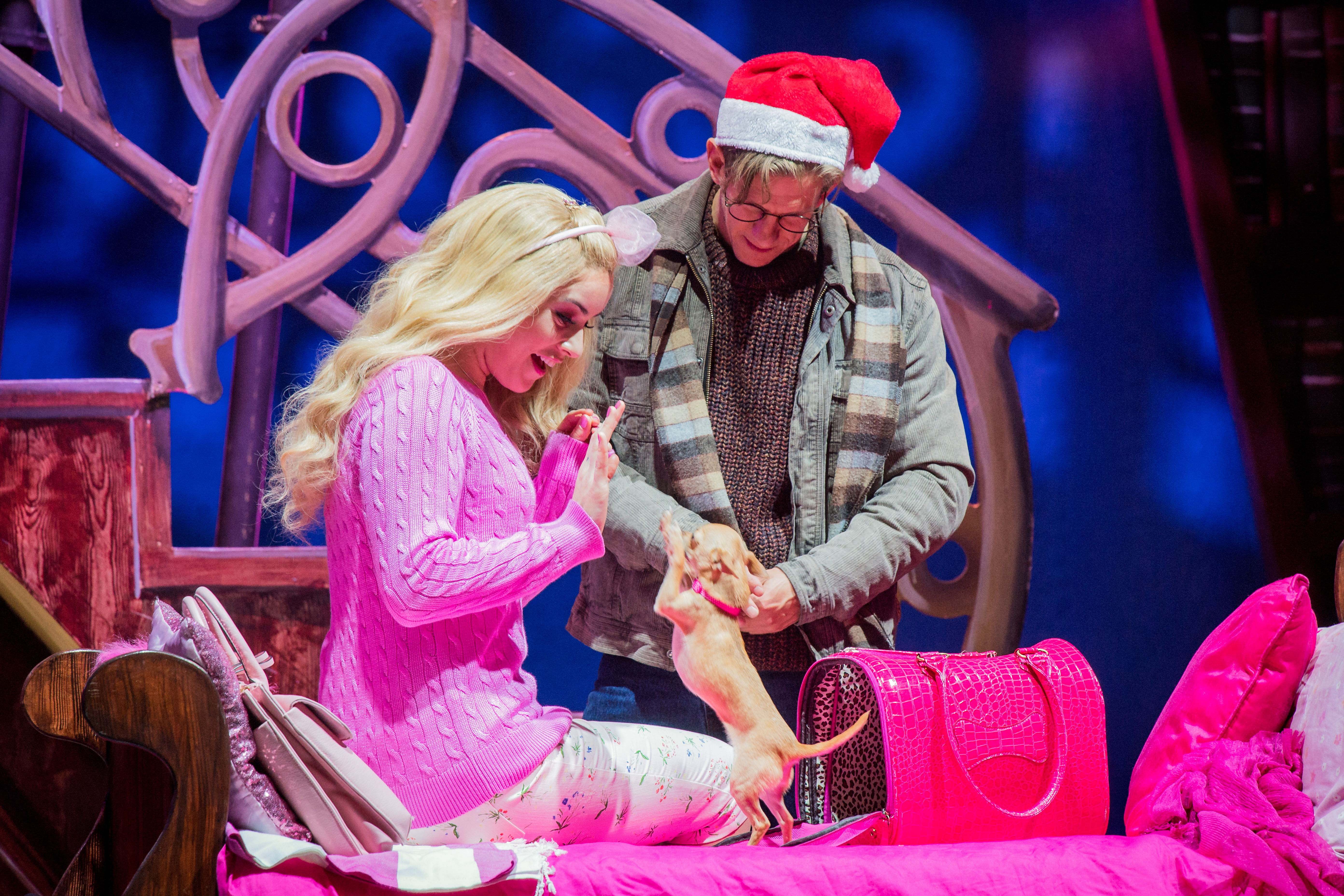 Legally Blonde the musical. Lucie Jones dressed in pink as Elle Woods, with Bruiser Woods, her Chihuahua and David Barrett as Emmett.