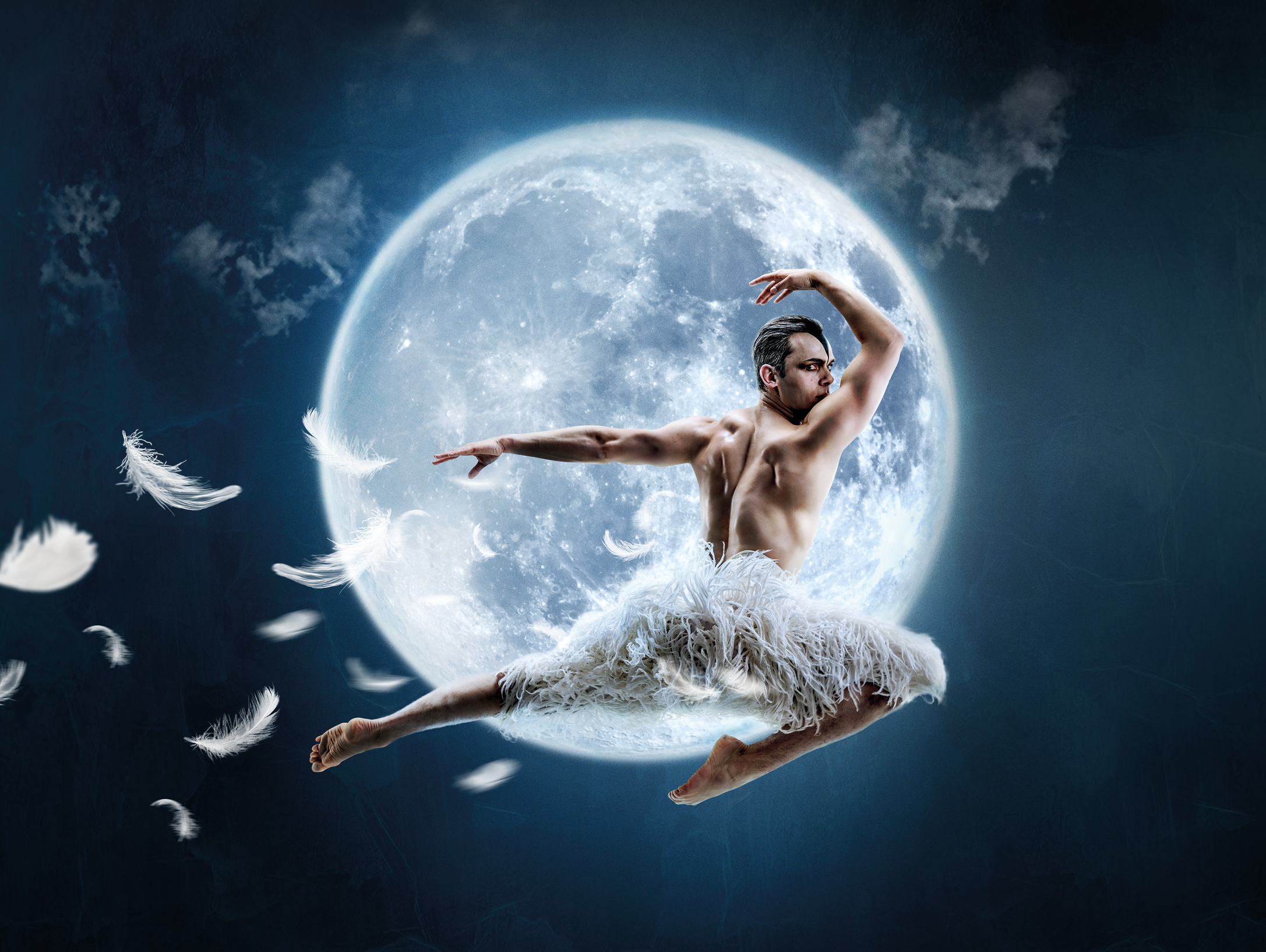 Matthew Bourne's Swan Lake. New Adventures production poster image showing a bare-chested male dancer leaping in front of a full moon.