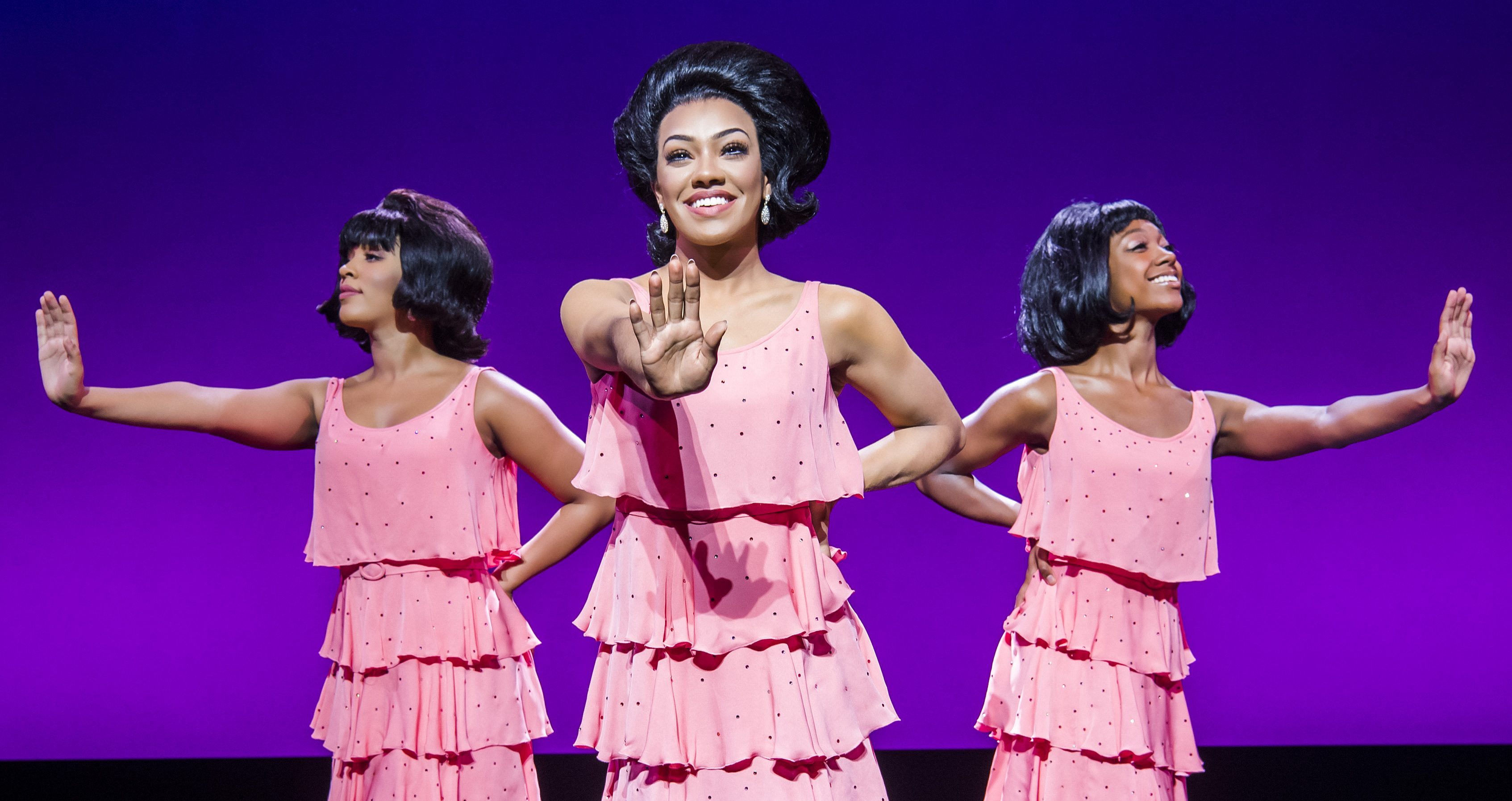 Motown the Musical. Three women in pink dresses, performing as Diana Ross and The Supremes in the theatre production, Motown the Musical. Photo by Tristram Kenton.