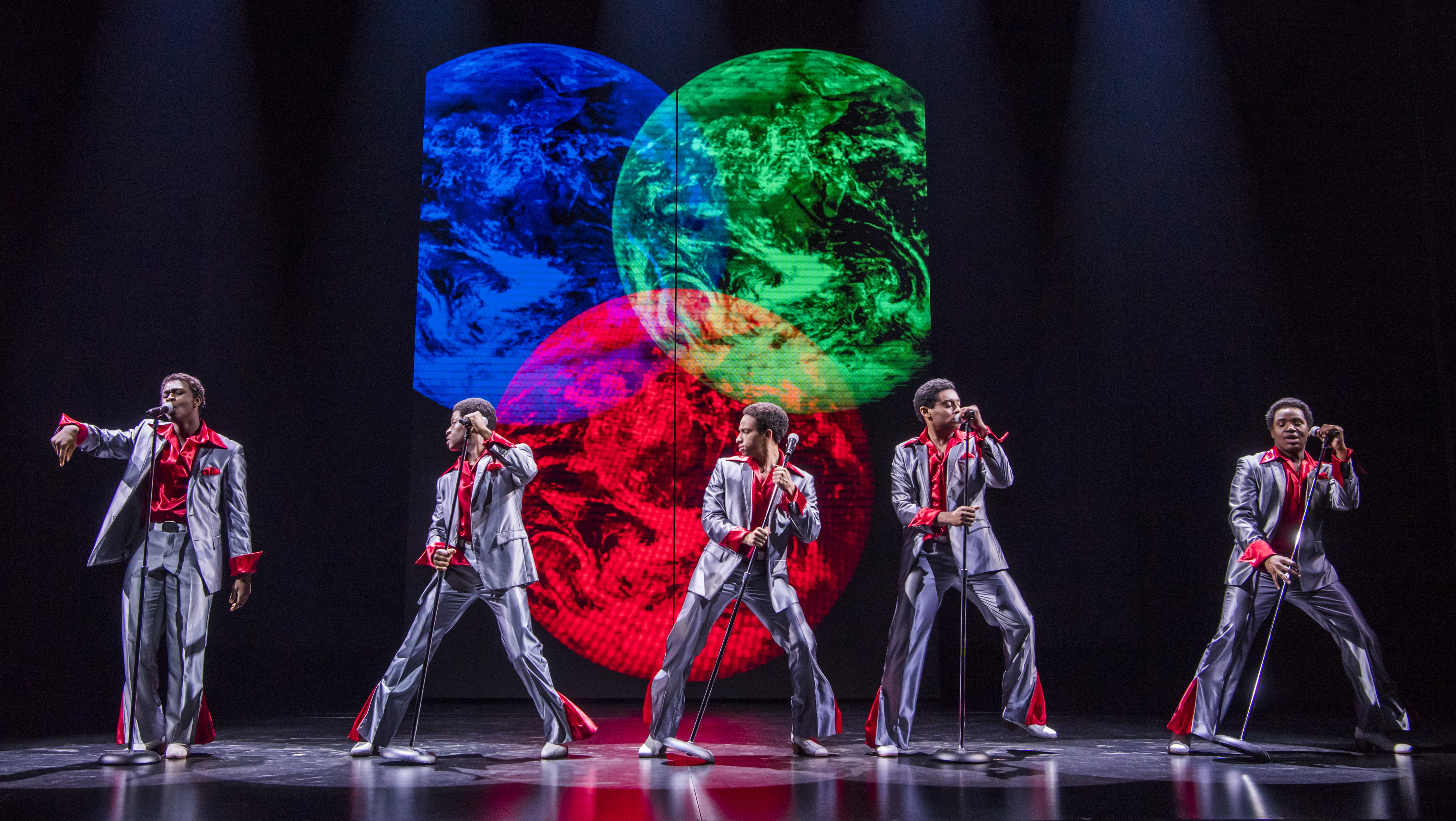 Motown the Musical. Five men in silvery grey suits performing as The Temptations in Motown the Musical. Production photography by Tristram Kenton.