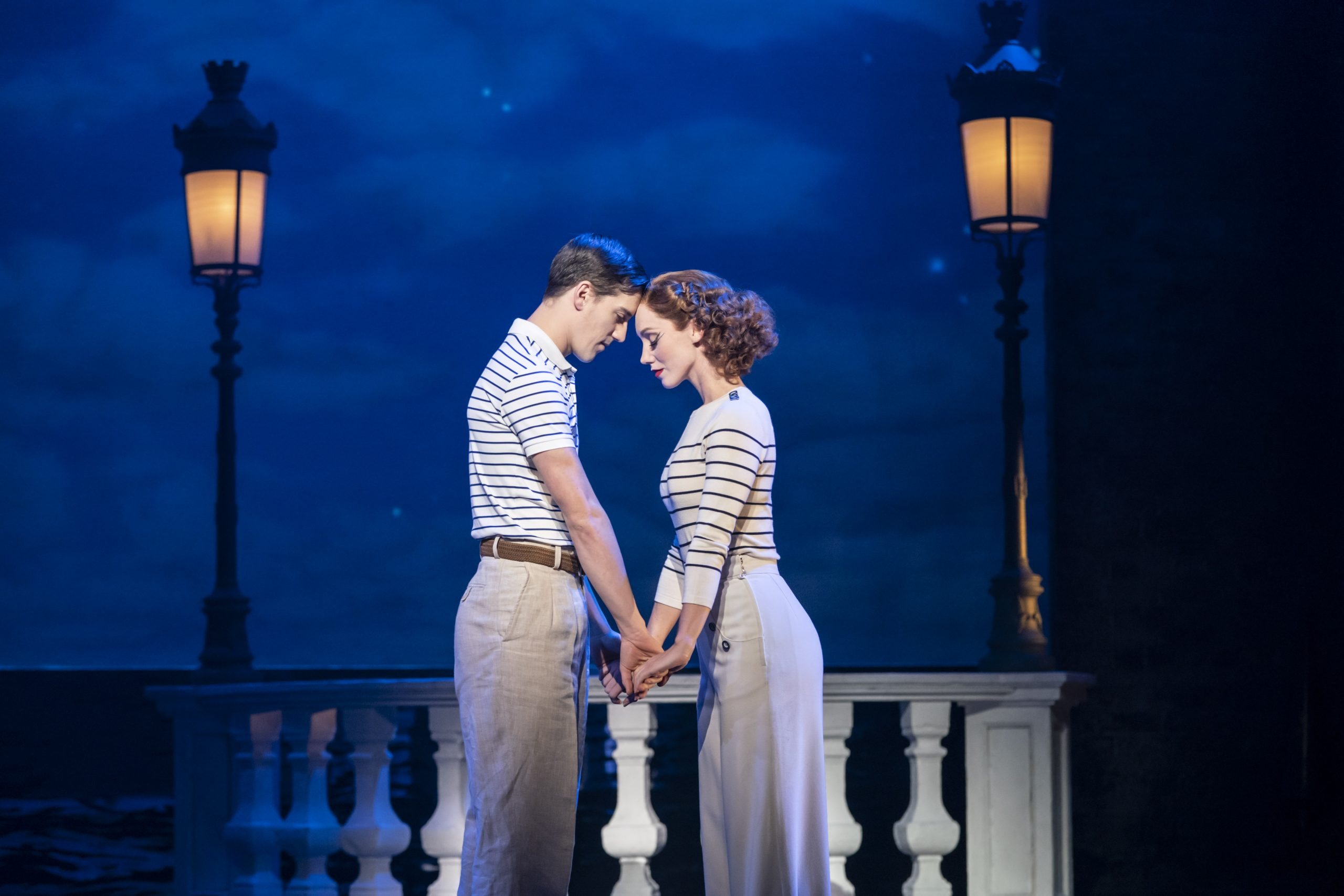 Matthew Bourne's production of The Red Shoes. Dominic North as Julian Craster and Ashley Shaw as Victoria Page.