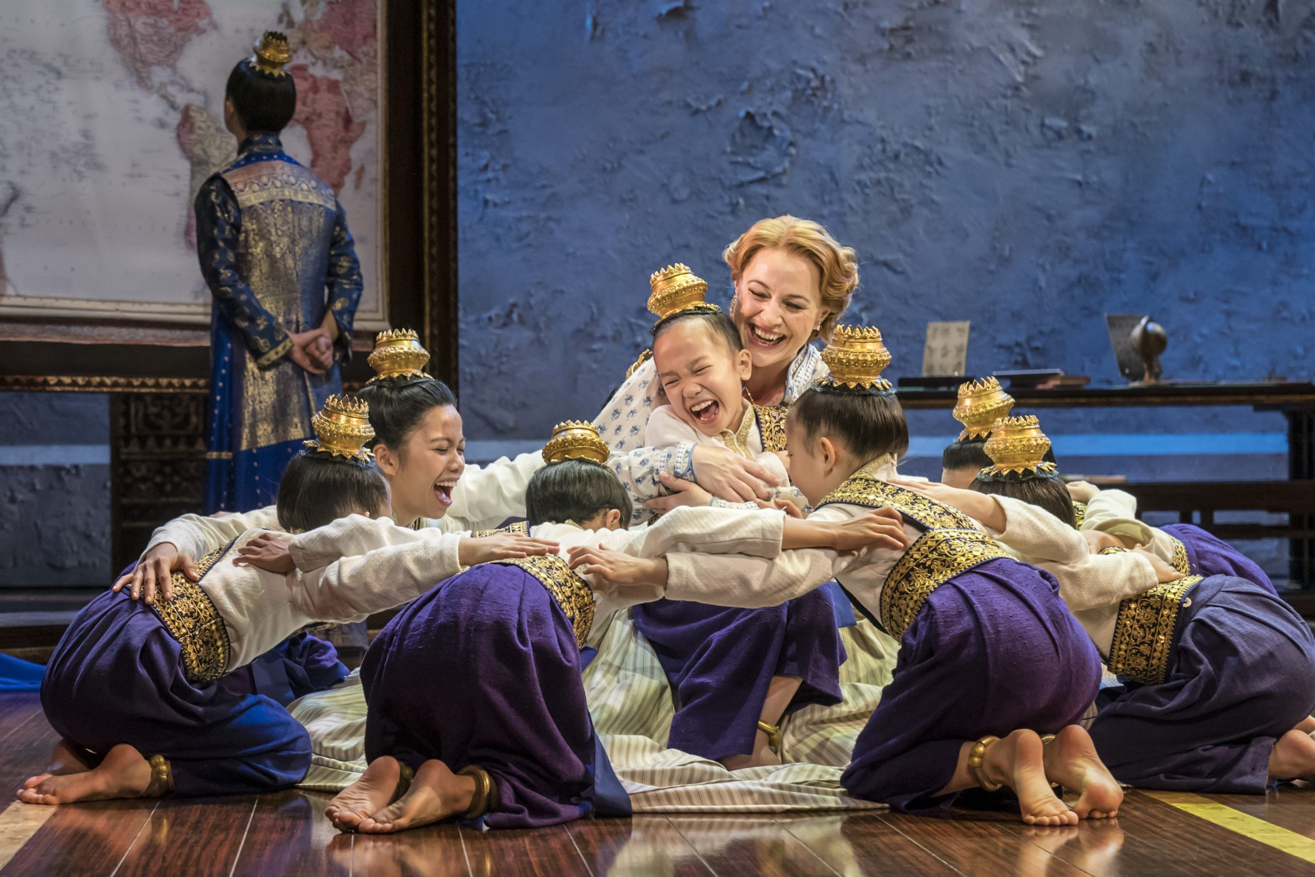 Annalene Beechey (Anna) surrounded by the King's children in Bartlett Sher's interpretation of Rodgers' & Hammerstein's classic musical, The King and I.