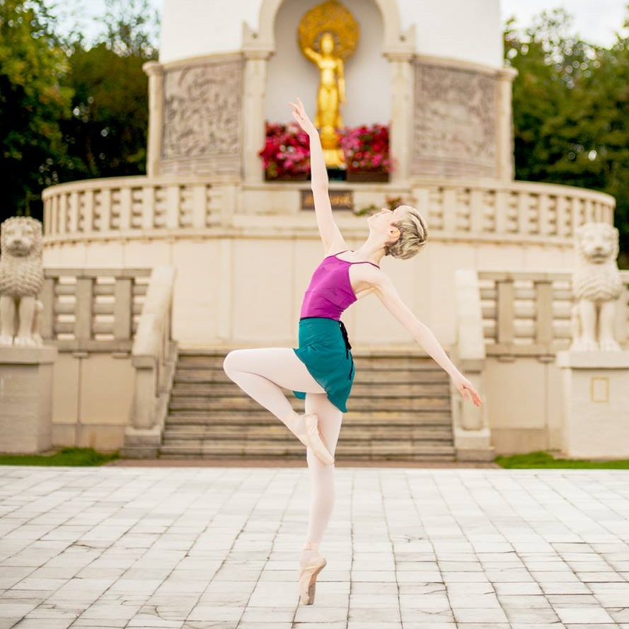 Georgina Butler, wearing a pink leotard and turquoise skirt, dancing outside. Photo by Terry Grehan.