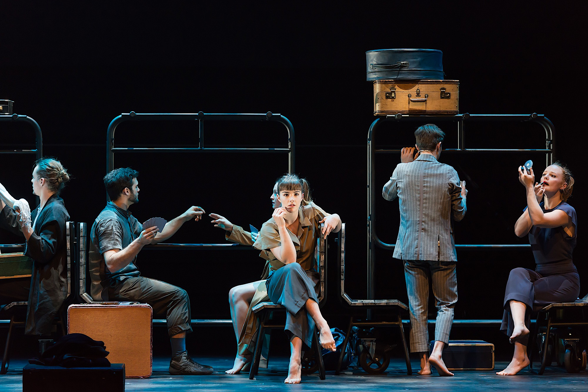 The 7 Fingers performs Passagers. The cast of circus artists use chairs and luggage trollies to recreate a busy train carriage.