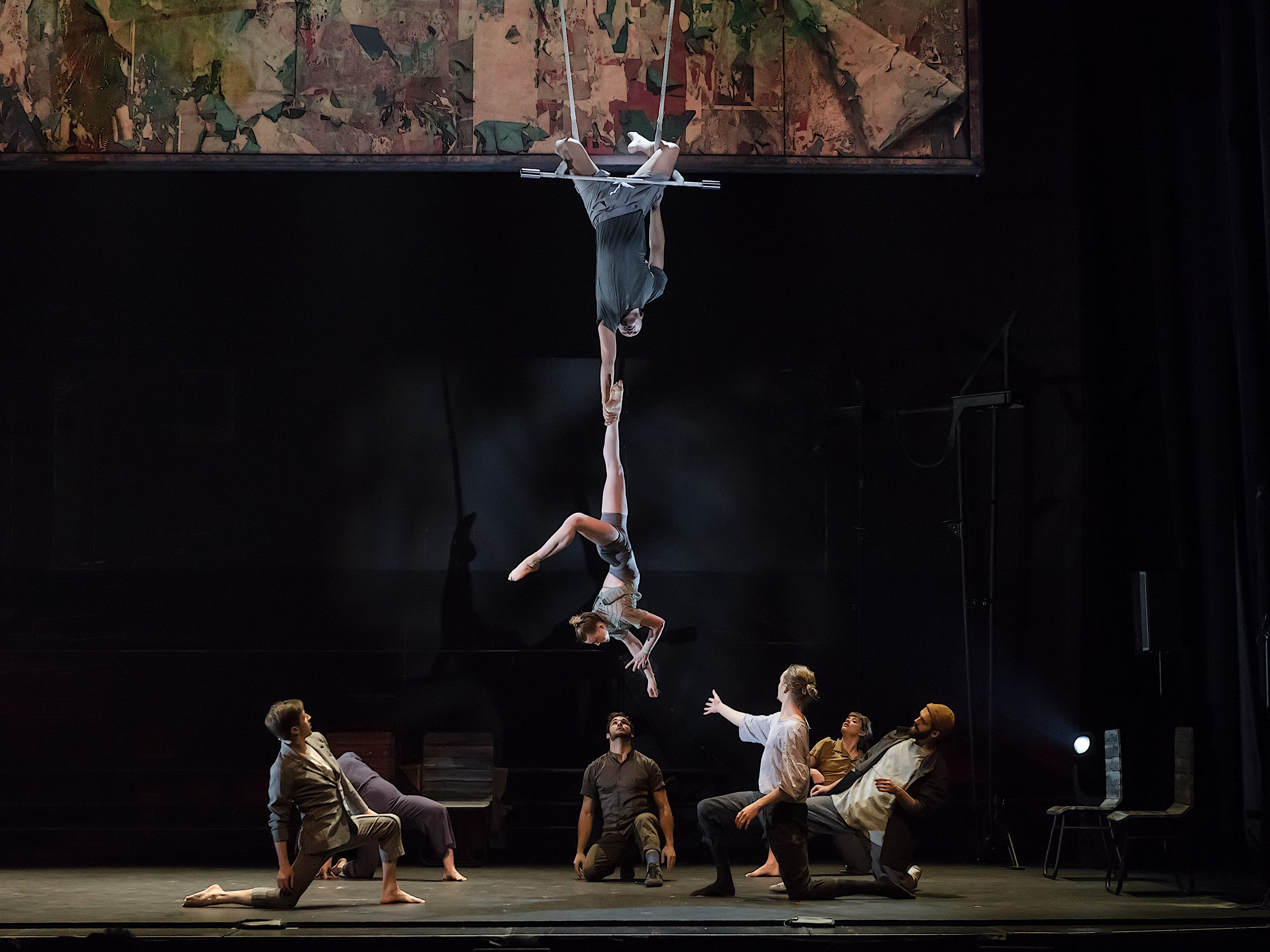 The 7 Fingers performs Passagers. Circus artists Sabine Van Rensburg and Sereno Aguilar Izzo perform an awe-inspiring trapeze act, hanging upside down above the stage.